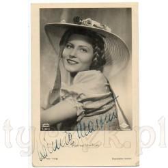 Piękna i młoda Winnie Markus w słomkowym kapeluszu na dawnej fotografii