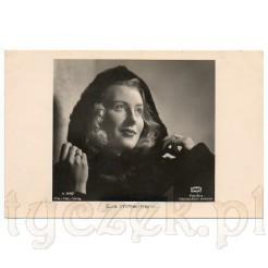 Młoda Eva Immermann w zimowym płaszczu na dawnej fotografii