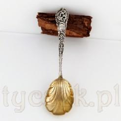 Duża srebrna łyżka do cukru i dodatków deserowych.