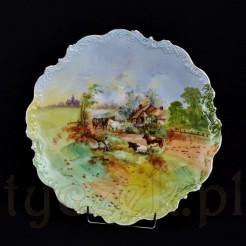 cenny antyk z porcelany zdobionej malowaną scenką wiejską