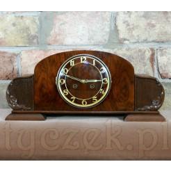 Ponadczasowa elegancja w postaci zegara do postawienia na komodzie czy szafce