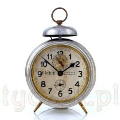 Budzik GF z reklamą zegarmistrza z Zawiercia