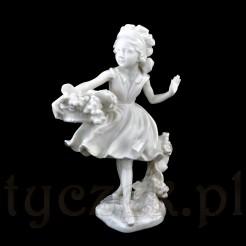 Urocza porcelanowa figurka