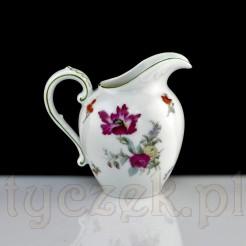 Niezwykły kwiat zdobi mlecznik z ok 1920 roku