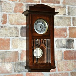 Markowy i dekoracyjny antyk -zegar ścienny marki Kienzle