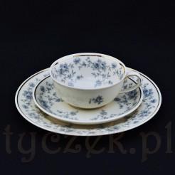 Sympatyzna i subtelna filiżanka do herbaty ze spodkiem i talerzykiem deserowym