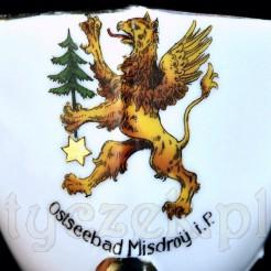 Znakomity herb: gryf na porcelanowej filiżance z podpisem