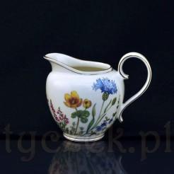 Cudowny mlecznik wykonany został ze szlachetnej porcelany o kremowej barwie