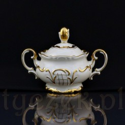 Niezwykle luksusowa cukierniczka z kremowej porcelany ociekająca złotem