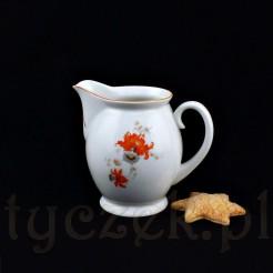 Uroczy mlecznik wykonany z białej porcelany posiada pękaty brzusiec