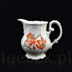 Efektowny mlecznik do mleczka lub śmietanki wykonany został ze śląskiej porcelany w odcieniu kremowym