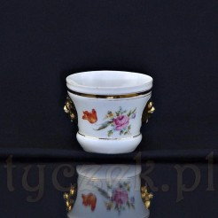 Niewielka doniczka zdobiona motywem wielobarwnych kwiatów