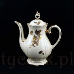 Wysoki i efektowny dzbanek do serwowania kawy z kremowej porcelany