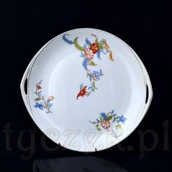 Oryginalna patera w formie talerza posiada dwa wyprofilowane uchwyty do podawania