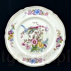 Niezwykle dekoracyjny talerz wykonany ze szlachetnej porcelany w kolorze kremowym