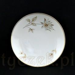 Subtelnie zdobiona złotymi kwiatami miseczka wykonana została z porcelany ecru