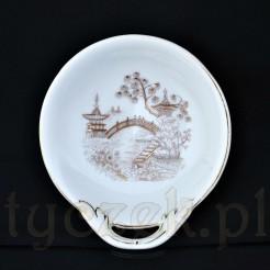 porcelanowa paterka służąca do serwowania przekąsek lub słodkości