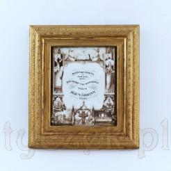 Znany biblijny cytat z Ewangelii według świętego Jana przedstawiony w dekoracyjny sposób na porcelanowej plakietce ujętej w profilowaną, złoconą ramę z drewna