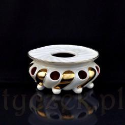 Podgrzewacz w formie ażurowej poręcznej wazy na nóżkach z pokrywką z otworem