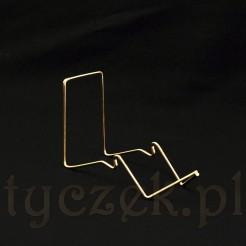 Luksusowy stojak w złotym kolorze na filiżankę ze spodkiem