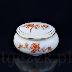 Owalne porcelanowe puzderko pięknie dekorowane znanym pomarańczowym motywem z epoki Art Deco