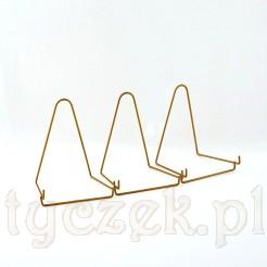 Komplet trzech stojaków w złotym kolorze