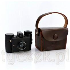 Zabytkowy aparat szpiegowski w oryginalnym etui.