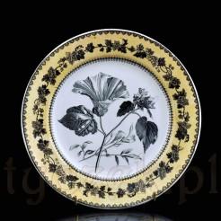 Fajansowy XIX-wieczny talerz z kwiatową dekoracją