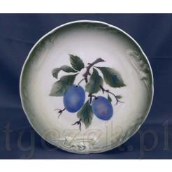 Śliwki zdobią secesyjny talerz ceramiczny