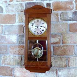 Luksusowy zegar wiszący w ciepłej kolorystyce drewna dębowego