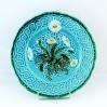 Dekoracyjny talerz majolikowy VILLEROY w kwitnące stokrotki na turkusie