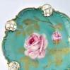 Pistacjowa patera Rosenthal Moliere z różą w centralnym polu