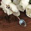 Przepiękna, zabytkowa srebrna łyżeczka dekorowana emaliowanym widokiem.